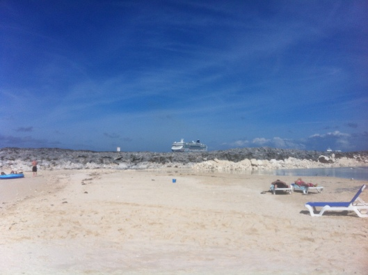 NCL Pearl anchored off in the distance from Great Stirrup Cay, Bahamas.