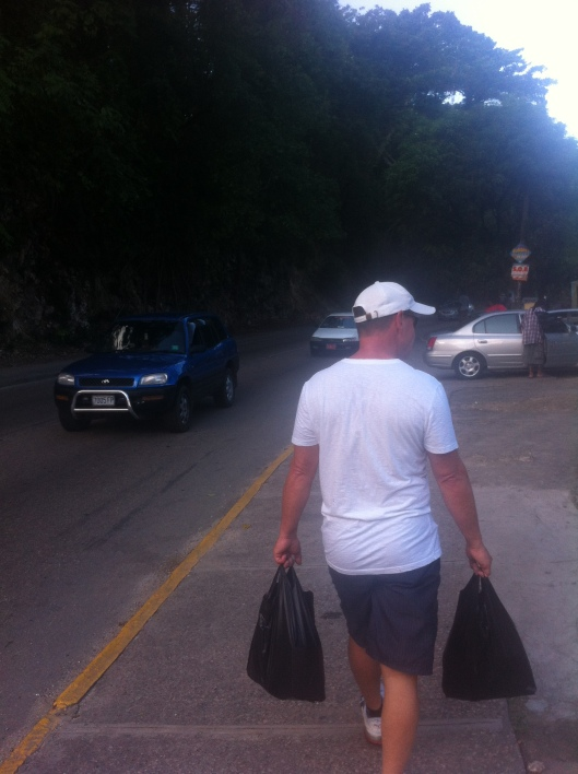 Michael walking back to the ship with the supermarket shopping in Ocho Rios, Jamaica.