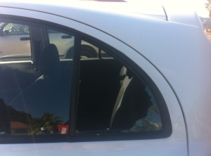 Toyota March window broken by thieves in St. Martin.