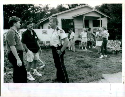 The first new-construction home in the downtown area for many years was built just north of the Round Lake area in what is now broadly known as Uptown.  This picture was taken for the St. Petersburg Times showing National Night Out Against Crime where the two community police officers from the Uptown neighborhoods attended along with others in the neighborhood to celebrate the new home being built at 1022 Eighth Street North.