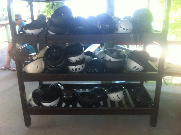 The helmet rack where everyone deposits their helmet and then the next group grabs one before they are called to get on their horse.