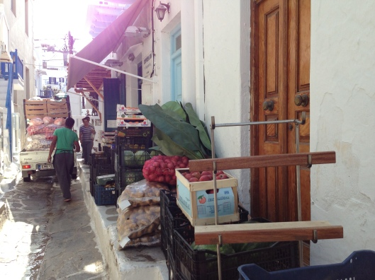 The local market gets a delivery of fruits and vegetables in Mykonos Town.
