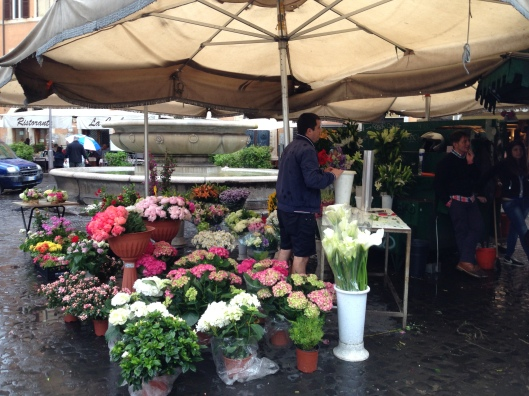 Flowers and spices and cheeses and lots of fabulous product were in the market at the Campo di Fiori, Rome, Italy.