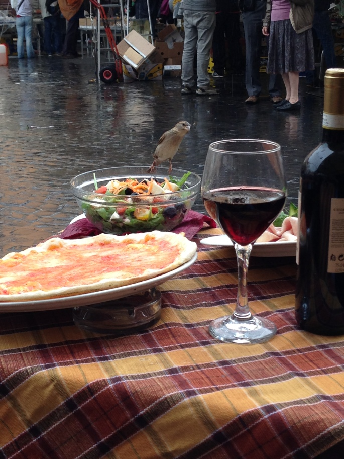 This little bird was anxious to eat salad and sip wine at Sloppy Sam's, Piazza Campo de Fiori, 9, 00186 Rome, Italy