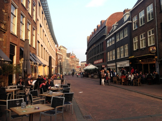 A typical street in Haarlem is filled with activity.