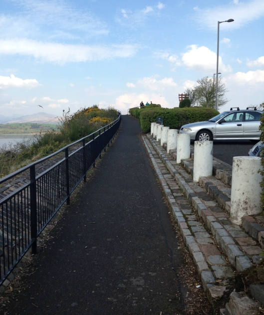 There is a place to park cars and some paved foot paths along the scenic section.