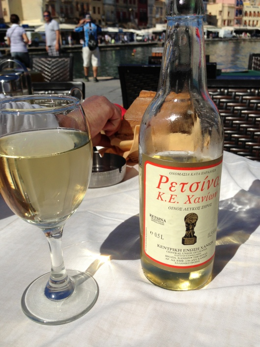 Nothing says Greece like a bottle of Retsina, a sidewalk cafe and a view of an incredible little charming harbour town.  Chania, Crete, Greece.