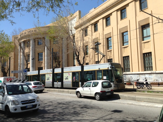 The modern tramway in Messina, Sicily approaches the Central Station.