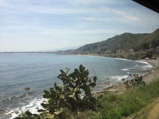 The views of the Italian coast on the main train route from Messina Centrale to Taormina-Giardini.