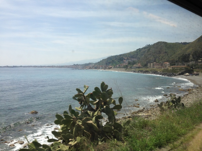The views of the Italian coast on the main train route from Messina Centrale to Taormina-Giardini.