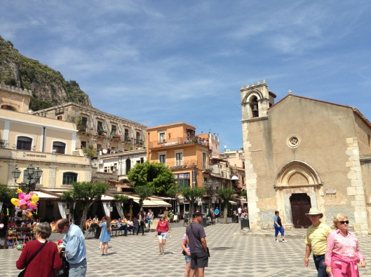 A main square in Taormina is filled with beauty as well as tourists.