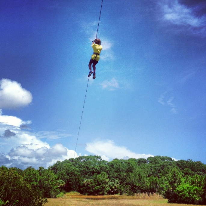What excitement this appears to be - the zip line at the Brevard Zoo.