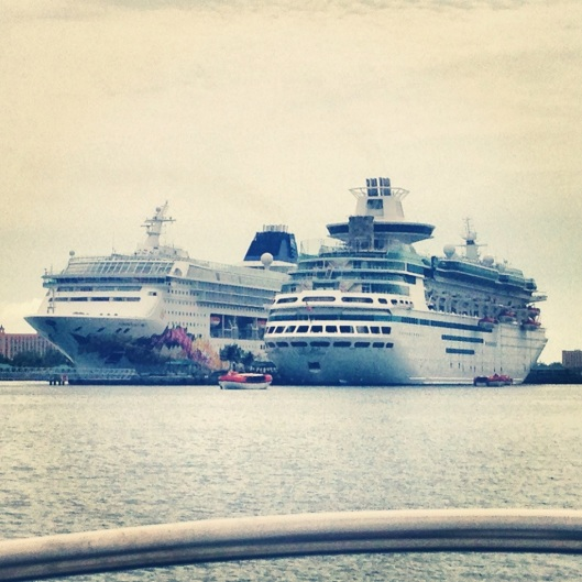 The Norwegian Sky sits on the left of the Royal Caribbean Majesty of the Seas in Nassau Harbour, Bahamas.