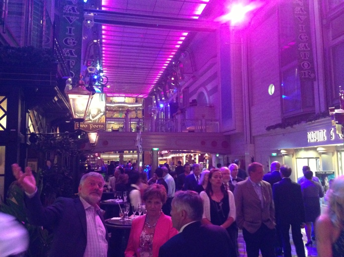Formal night promenading on the Royal Promenade of the Royal Caribbean Navigator of the Seas.