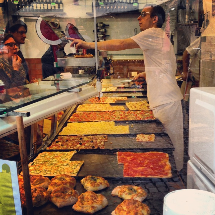 It is so difficult to pass so many great shops without stopping in for a bite of something.  Here is a pizza shop along the bus route 40 in Rome.