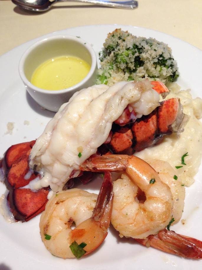 The delicious lobster tail and shrimp dinner in the Elation Dining Room on board the Carnival Paradise.