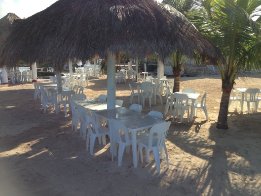 Palapas line the waterfront at the Playa Corona Beach Club in Cozumel, Mexico.