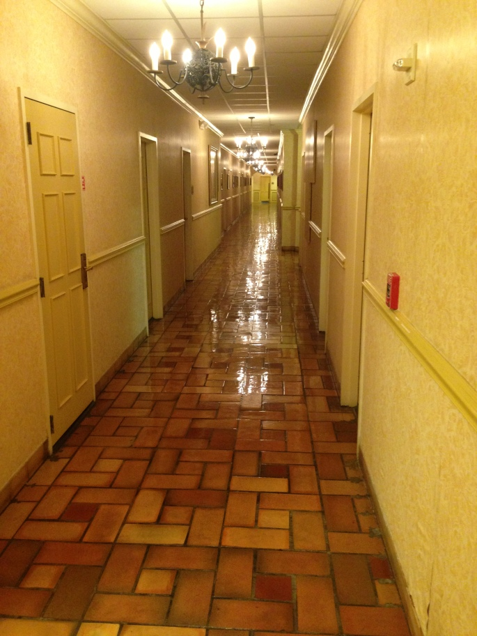 Ground floor corridor with incredible polished floors and historic photographs on the walls of the Riverside Hotel, Las Olas Blvd., Ft. Lauderdale.