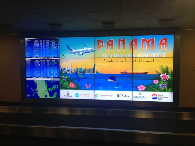 An advertisement at the TPA Baggage Return zone promotes the new TPA - Panama service on COPA Airlines.