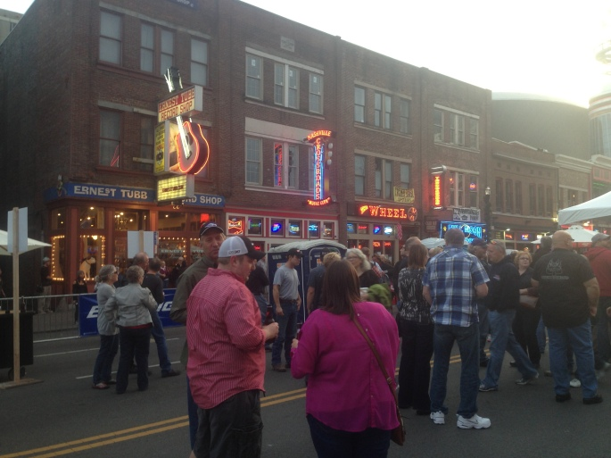 A concert takes place on Broadway in a one-block section that is closed to traffic in downtown Nashville, Tennessee.