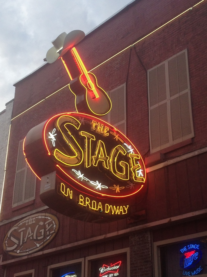 A neon sign for The Stage on Broadway in downtown Nashville, Tennessee.