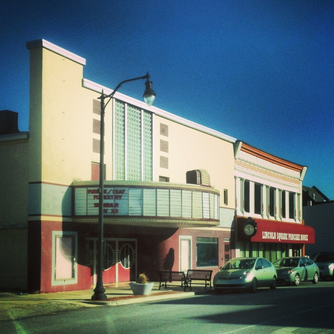 A theater (now an arts center) and restaurant, Lincoln Square Pancake House, line Main Street (the National Road) in Greenfield, Indiana.