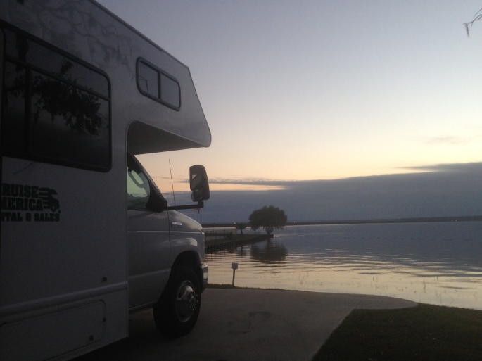 Our rented RV from Cruise America sat on a nice concrete pad with water views of Lake Livingston at the KOA in Onalaska, Texas.