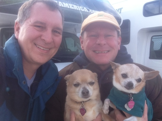 Here we are with our two chihuahuas picking up the RV in the background in Chicago ready to start discovering the country in our RV.