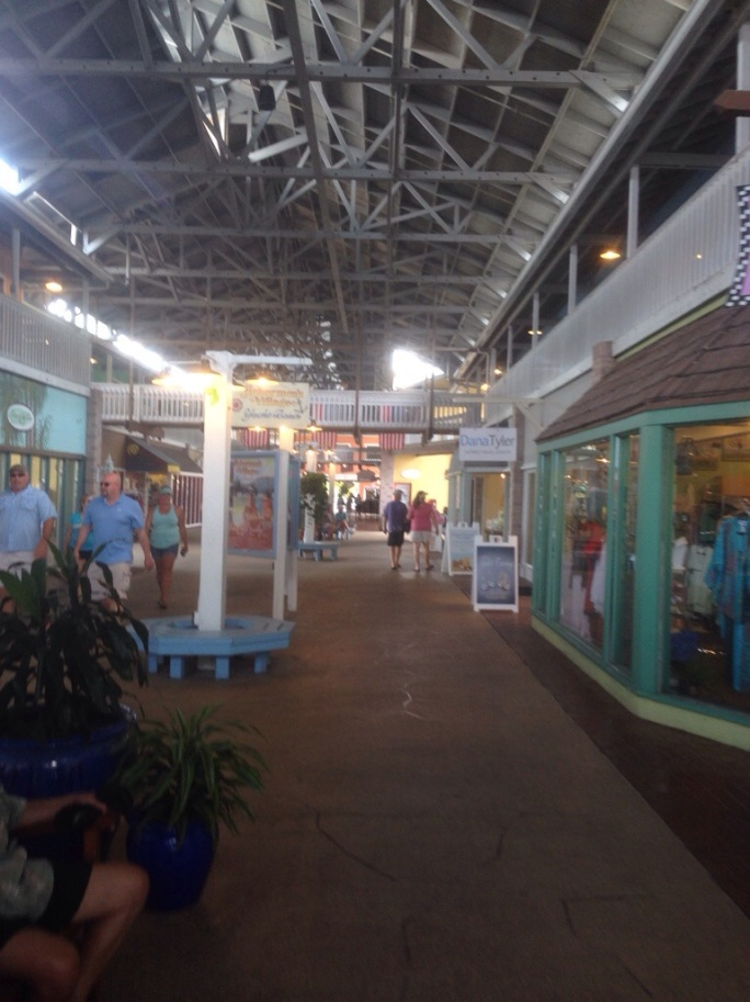 The covered walkway along modern shops at Fisherman's Village in Punta Gorda, Florida.