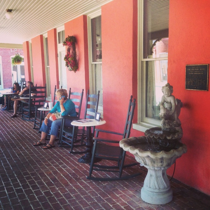 The porch of the Atlantic Hotel is a great place to relax after lunch at the Drummer Cafe.