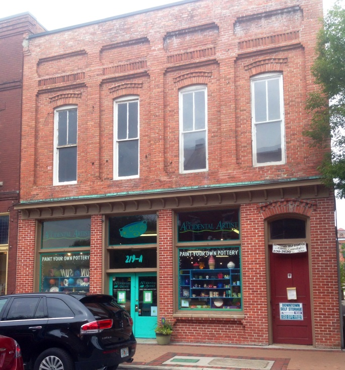 Downtown is filled with many charming brick buildings, including this one that houses a paint-your-own-pottery facility.