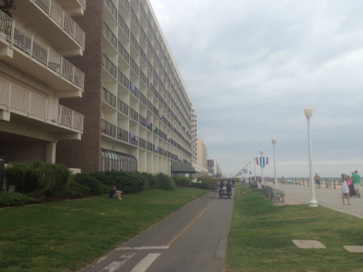 The boardwalk at Virginia Beach isn't wood and doesn't have any arcades or shops but lots of hotels.